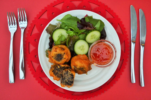 Beer Battered Haggis Balls on a plate with salad and dip