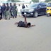 Woman lays in the middle of a busy road to protest over 13 months unpaid salary