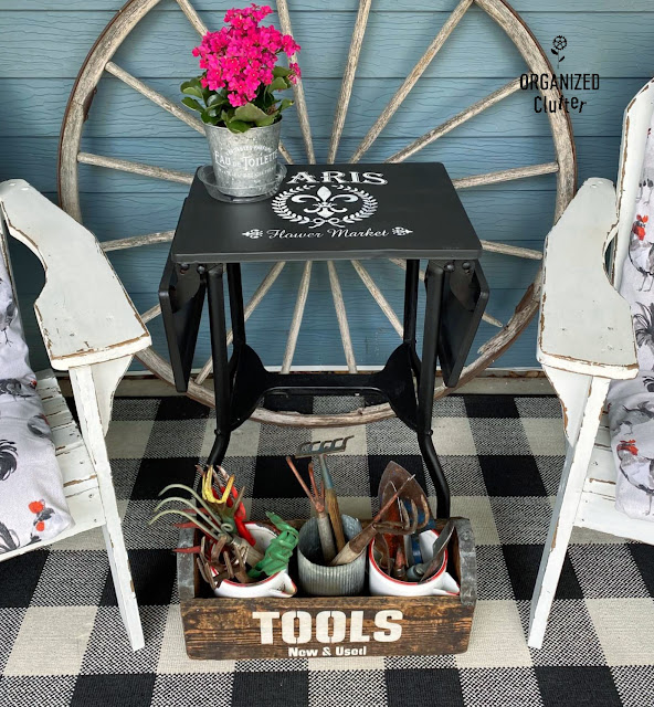 Photo of vintage typing table with new paint & stencils on the patio