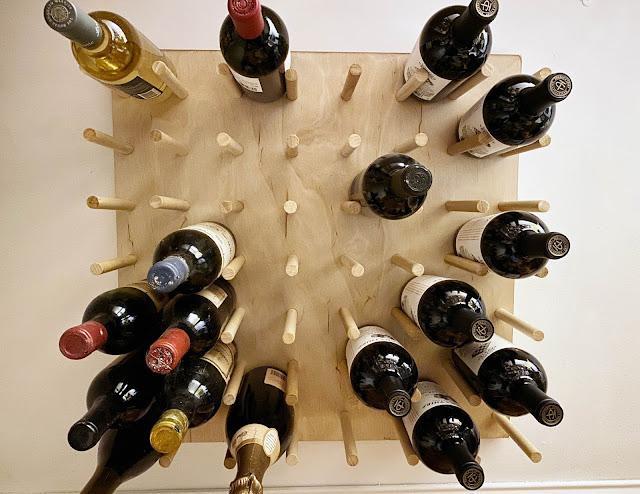 DIY oversized wall mount pegboard wine rack