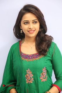 Actress Sri Divya Pictures in Green Salwar Kameez at Rayudu Team Meet  0035.JPG