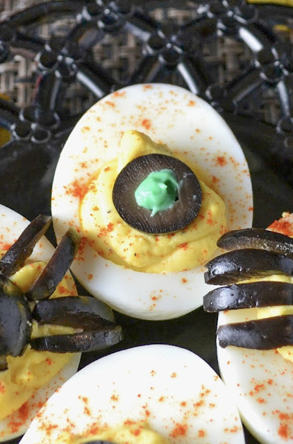 close up of creepy eye deviled egg on a plate.