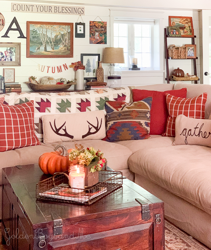 Fall decor in family room with planked shiplap walls - www.goldenboysandme.com
