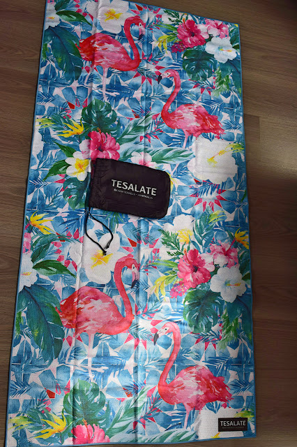 Tesalate towel - Paradise Found laid out on floor with bag