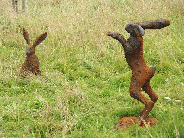 Lifelike hares in the Orchard