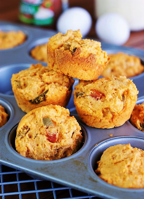 Spicy Salsa Muffins Showing Flecks of Salsa Pieces Throughout Image