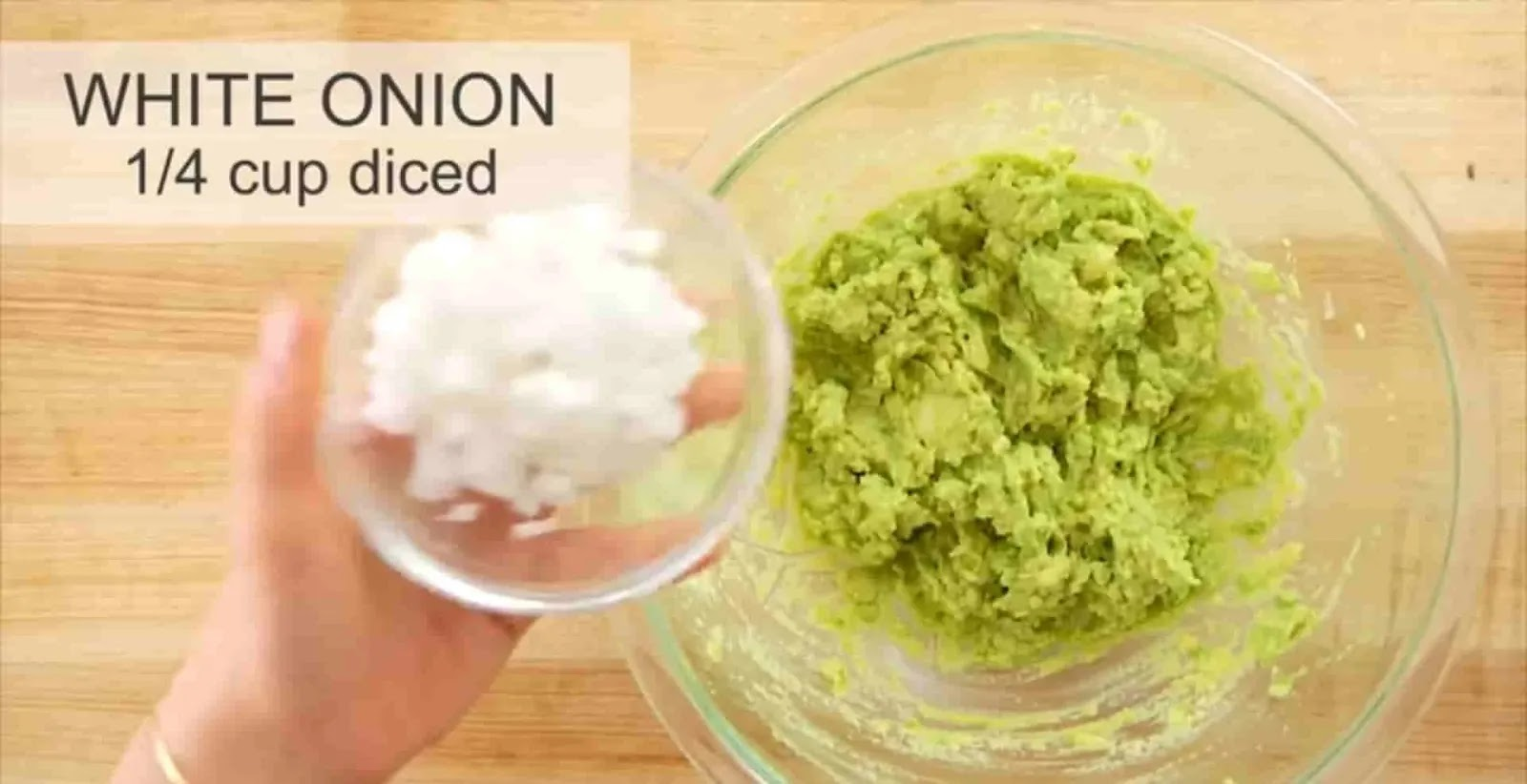 adding-white-onion-in-mashed-avocado