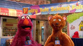 """Monster on the Spot reporter Telly and """"cub reporter"""" Baby Bear are covering Sesame Street's Fairy Tale Science Fair. Sesame Street Episode 4320 Fairy Tale Science Fair season 43"""