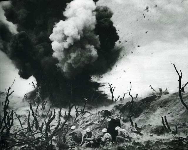 An explosion on Iwo Jima worldwartwo.filminspector.com