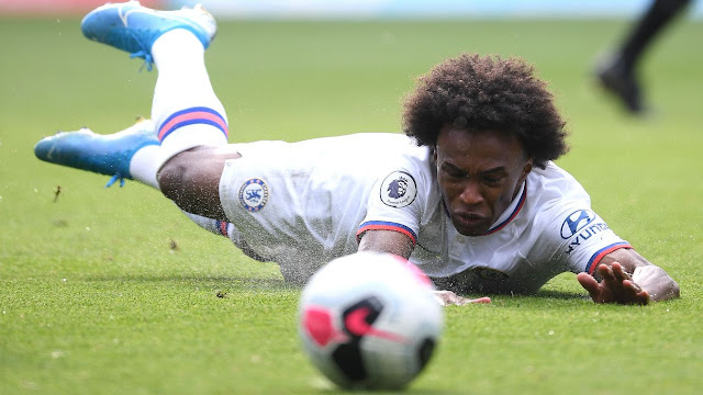 Willian goes to ground under a challenge during Chelsea's 2-5 win away at Wolves during a Premier League match earlier in the season.