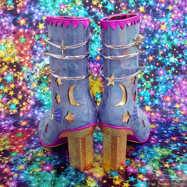 boots with gold heels and stars and moon cut outs on uppers