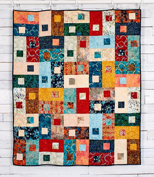 Next Move Quilt designed by Osie Lebowitz for Timeless Treasures, features Tonga Treat collection