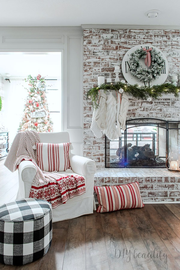 rustic fireplace with neutral decorated Christmas mantle