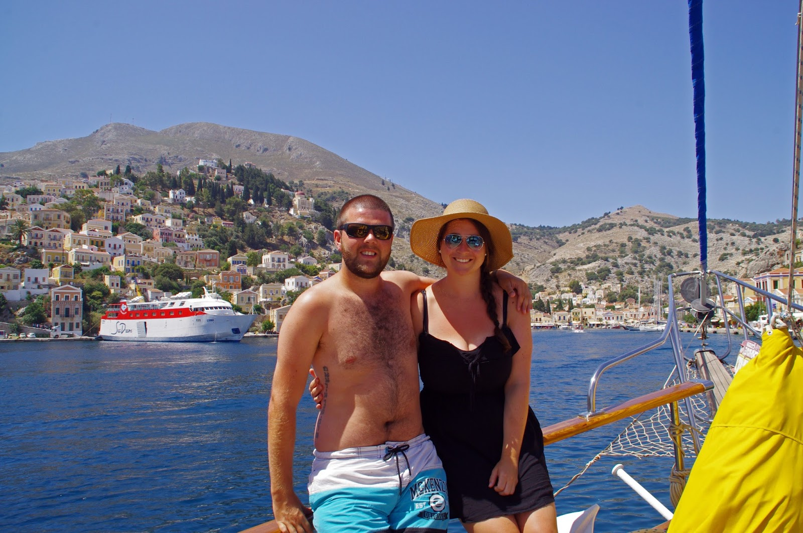 Couple Sailing into Simi Island Greece