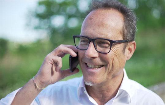 A male adult making a phone call
