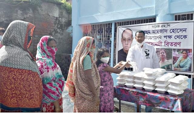সাবেক এমপি মরহুম আমজাদ হোসেন ফাউন্ডেশনের উদ্যোগে গরিব ও দুস্থ পরিবারের মাঝে খাদ্য সামগ্রী বিতরণ