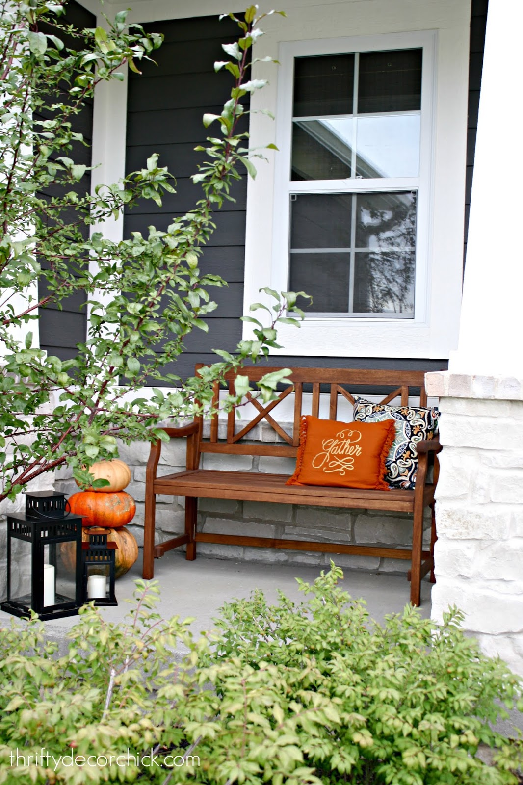 Wood bench on porch fall decor