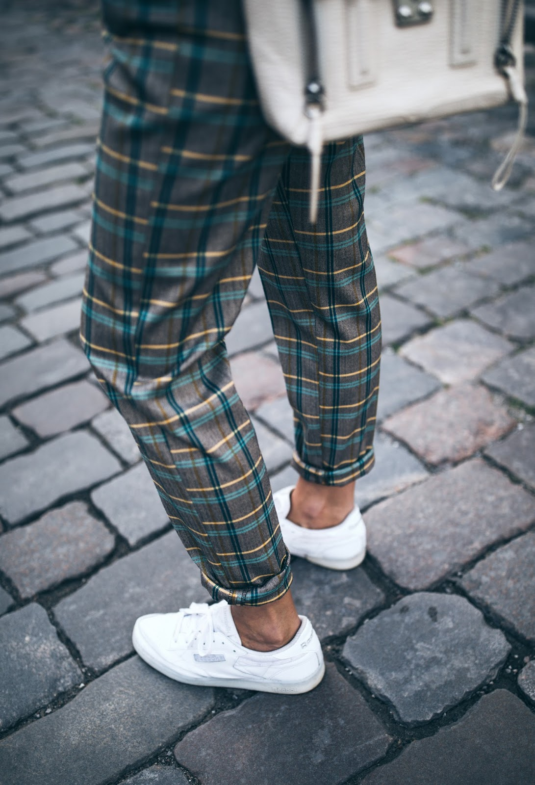 checked pants sneakers
