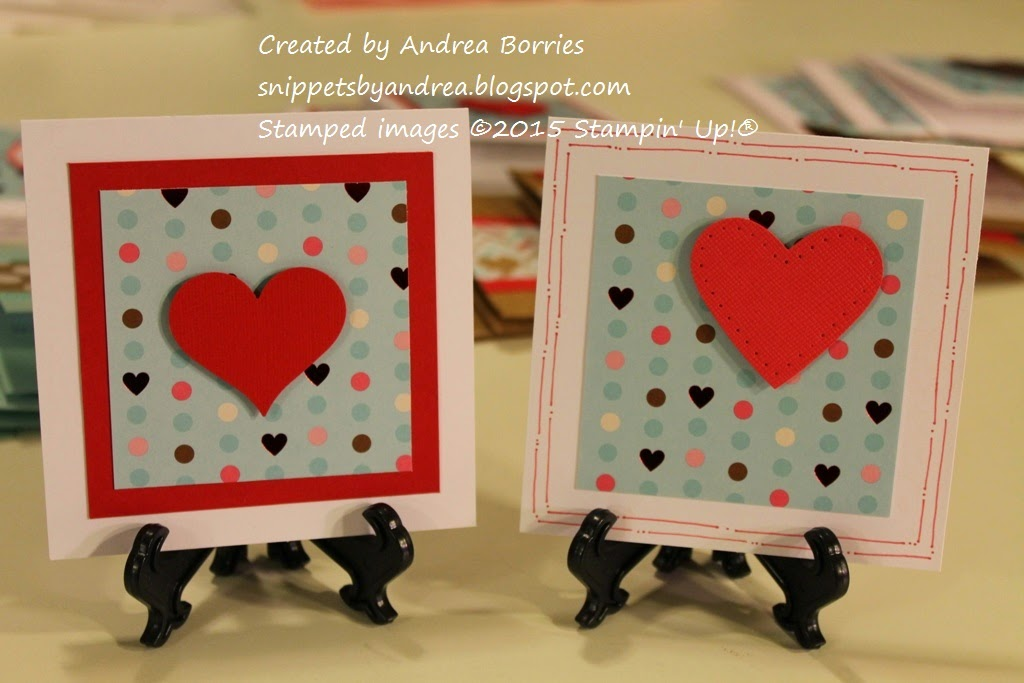 Two valentines with a background of polka-dot paper and a punched heart as the focal point.
