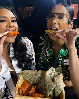 Tyrina Enjoying Wings With Her Friend Brook