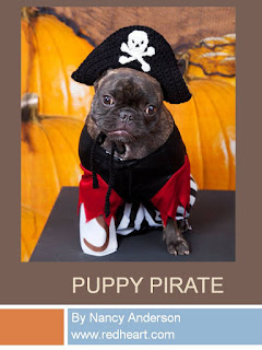 http://www.redheart.com/free-patterns/puppy-pirate-hat