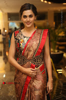 Tapsee Pannu Latest Stills in Red Silk Saree at Anando hma Pre Release Event .COM 0014.JPG