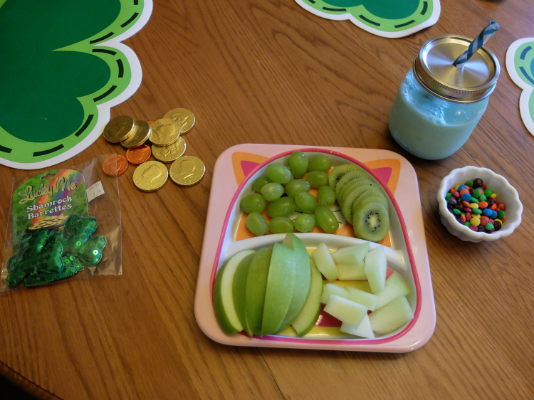 green fruit for St. Patrick's Day, green milk, gold coins, shamrocks