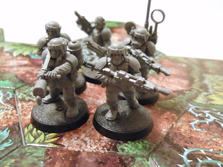 A group of Imperial Guard regulars prepare to face the genestealers in Lost Patrol