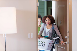 Young woman with mother moving into apartment