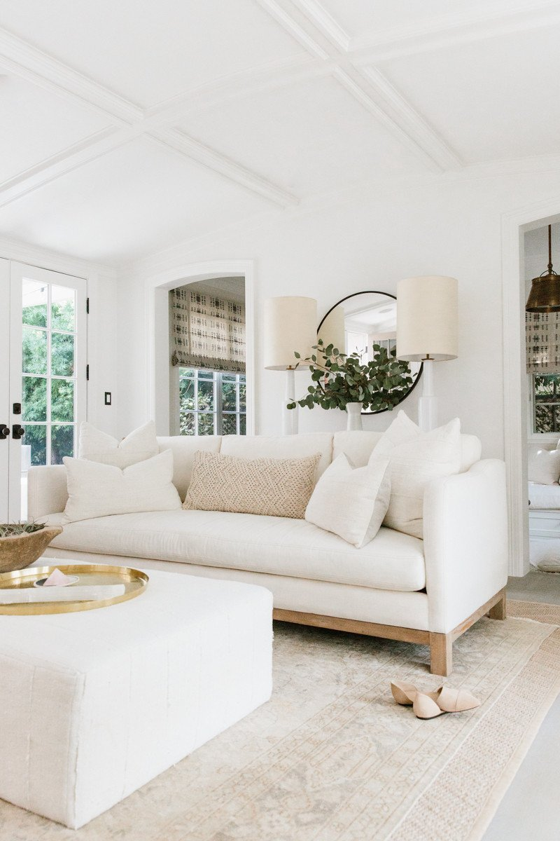 Erin Fetherston's white living room in LA. Come explore more California modern farmhouse interior design inspiration! #modernfarmhouse #livingrooms #whitedecor #interiordesign