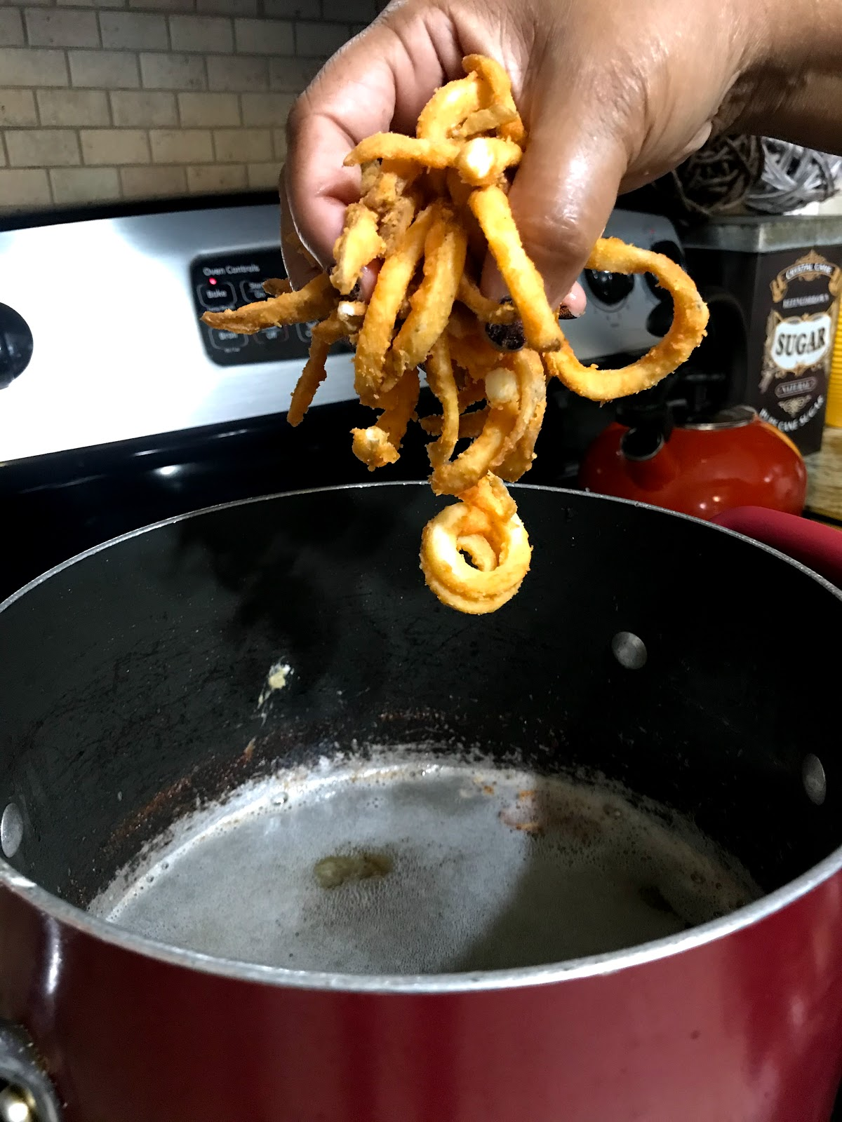 Image: Tangie is frying french fries to accompany her honey bun chicken sandwich
