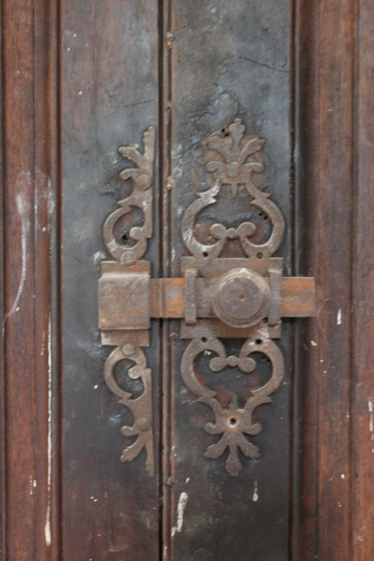 Detail of antique door hardware escutcheon in French Chateau Gudanes