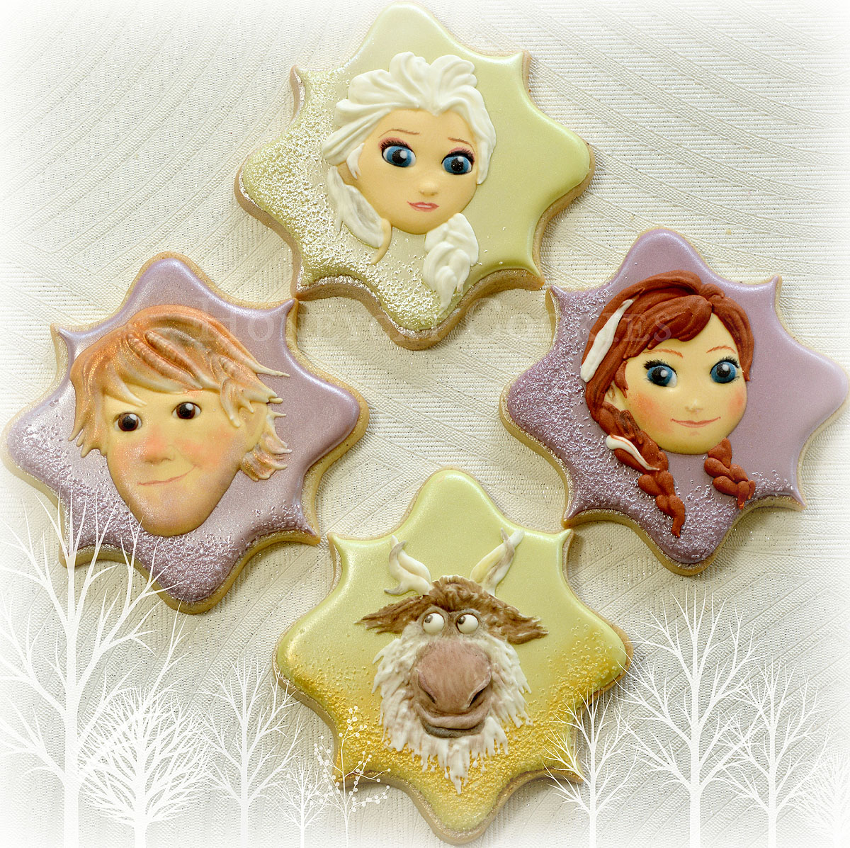 Elsa, Anna, Kristoff and Sven from Frozen, decorated cookies by Honeycat Cookies