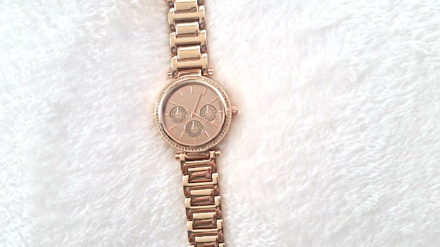 avon rose gold watch