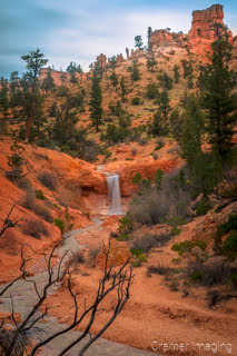 Cramer Imaging's fine art landscape photograph of a waterfall and red hoodoos at Bryce Canyon National Park, Utah