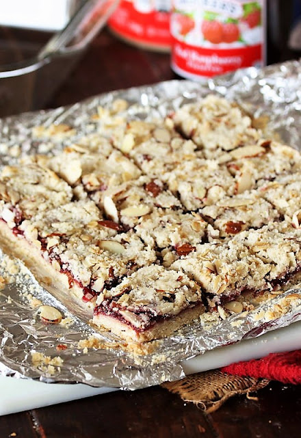Cutting Raspberry-Almond Bars into Squares Image