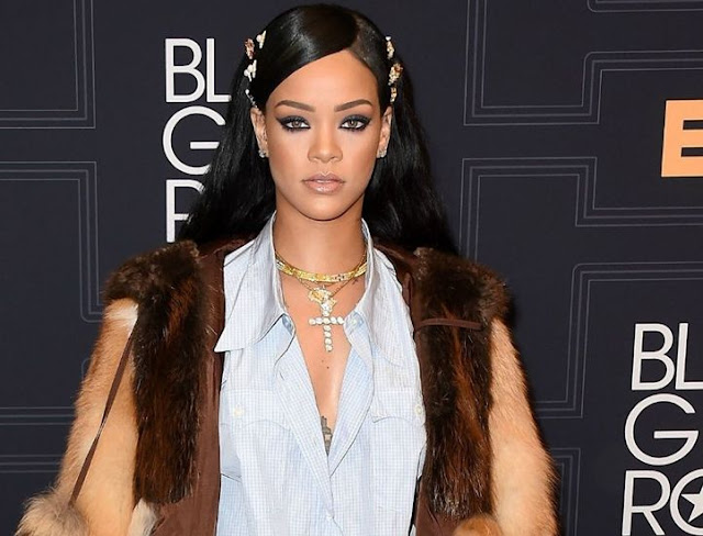 Rihanna Claps Back To Her Pregnant Rumor