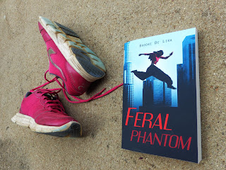 Parkour book Feral Phantom next to training shoes