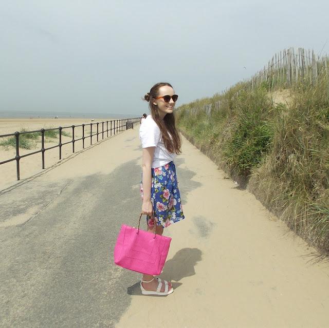 candid shot, smile, sunglasses, la moda dahlia handbag, white flatform studded sandals