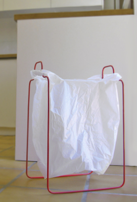 frame that holds a plastic bag, making it a wastebasket
