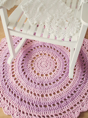 http://crafts.tutsplus.com/tutorials/crochet-an-amazing-mandala-floor-rug--craft-6032