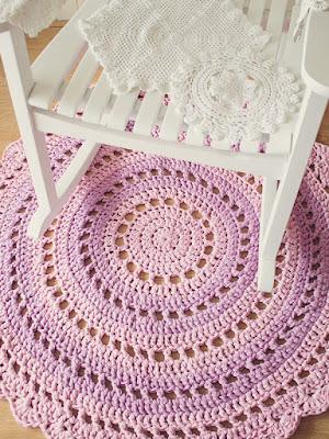 http://crafts.tutsplus.com/tutorials/crochet-an-amazing-mandala-floor-rug--craft-6032