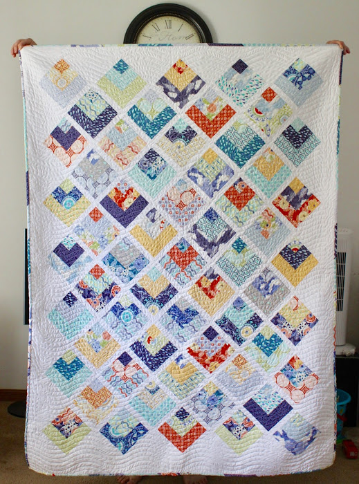 Quarter Log Cabin Quilt designed by Amista Baker