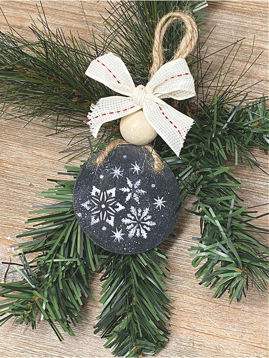 chalkboard ornament with stenciled snowflakes