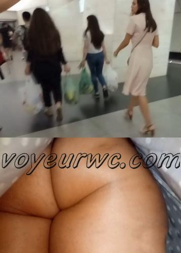Upskirts 4469-4478 (Secretly taking an upskirt video of beautiful women on escalator)