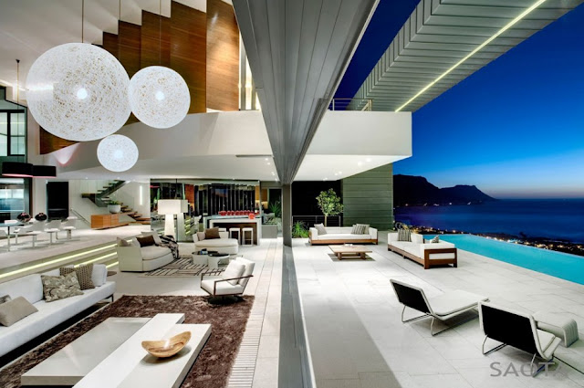Photo of large living room right next to the terrace and pool with the view