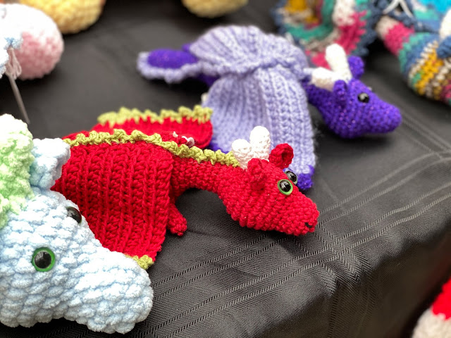 Crocheted dragon soft toys in white, red and purple