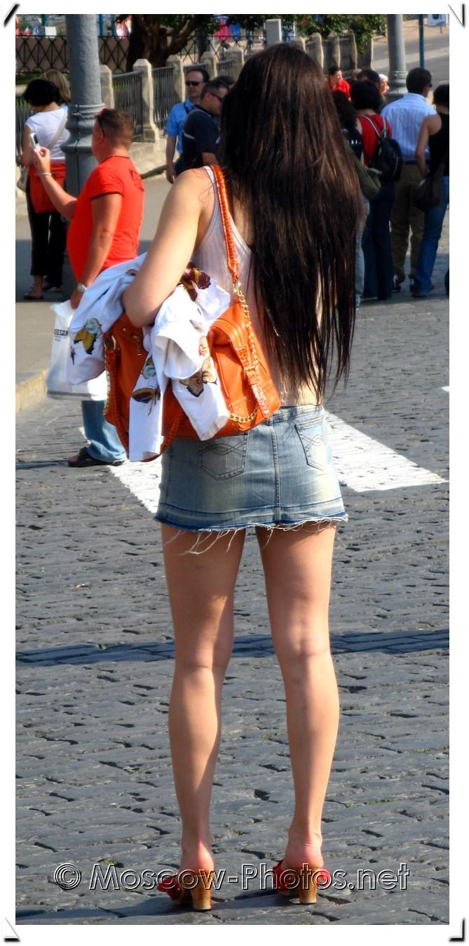 Brunette girl in jean micro skirt