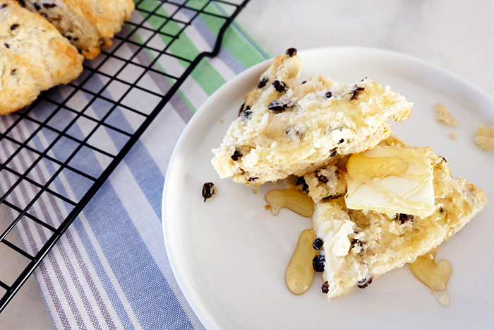 currant scone with butter and honey