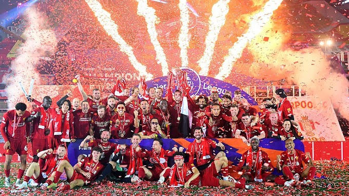 Liverpool lifts Premier League trophy after thrashing Chelsea 5 - 3 at Anfield
